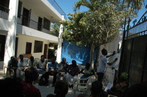 AUMOHD President Evel Fanfan facilitating a labor rights meeting
