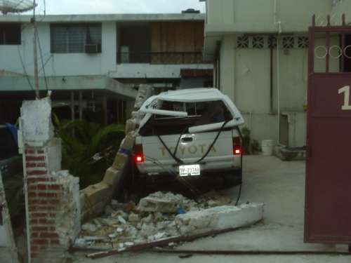 Destroyed vehicle in driveway adjacent to AUMOHD HQ